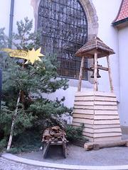 Kometo ĉe la Betlehema kapelo en Prago kondukanta al tradicia kristnaska ekspozicio en la kelaro