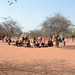 Namibia, Tourists in the Traditional Himba Village of Onjowewe