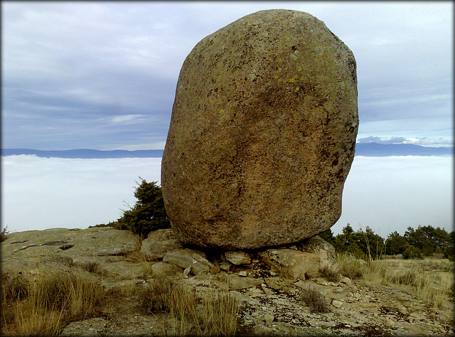 Granite boulder above a sea of fog.