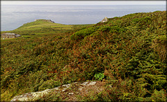 Bosigran Head and the Carn Galva Tin Mine Count House from the approaches to Carn Galva.