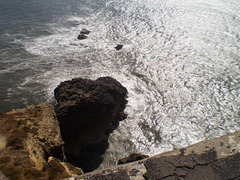 Looking down the cliff.