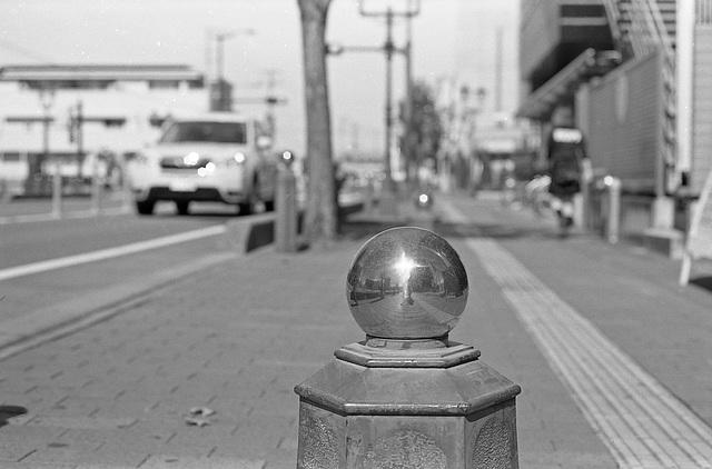 Balls on the sidewalk