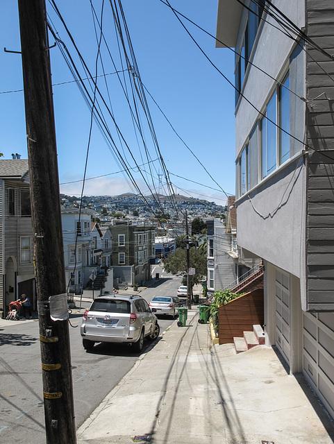 Rolling downhill on a sidewalk.