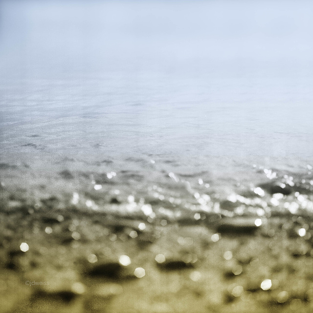 water meets  sand