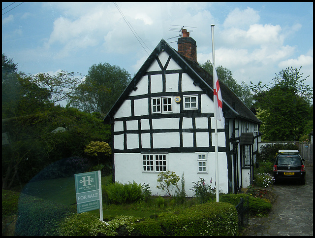 cottage with flagpole