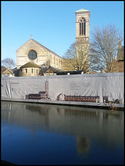 fenced-off canalside church