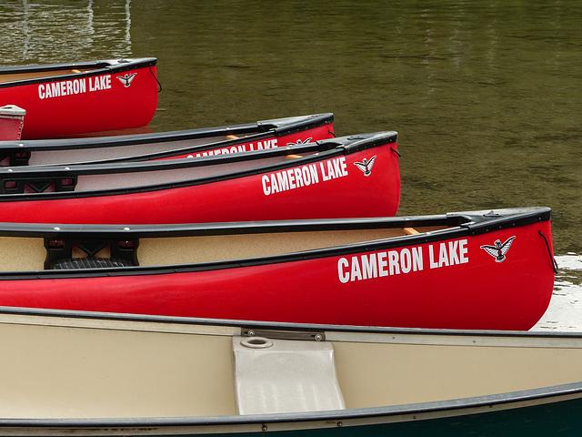 Red canoes at Cameron Lake, Waterton Lakes National Park