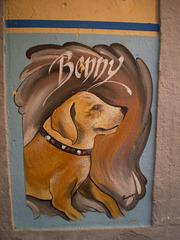 Street art on wall of restaurant.