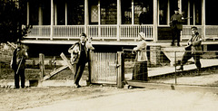 Men, Women, Dogs, and Guns in Front of a House (Cropped)