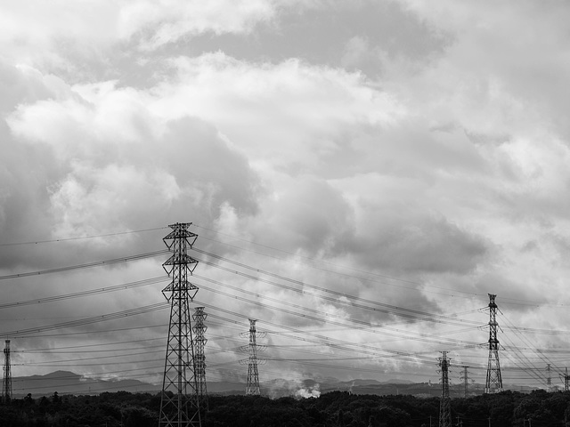 Power towers under rain clouds