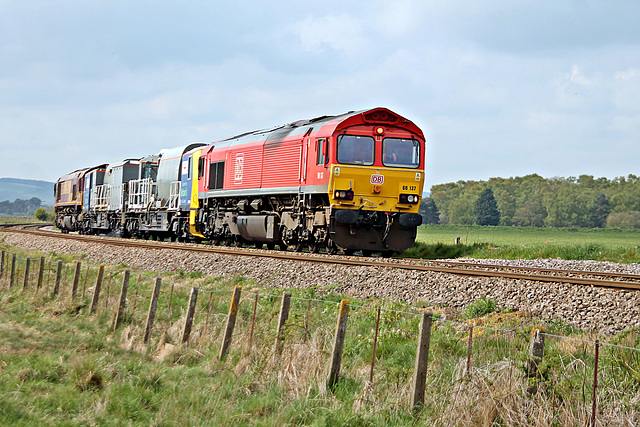 DB Cargo UK class 66 66137 with 3Z12 09.25 Knottingley T.M.D. - Knottingley T.M.D. via Scarborough,Bridlington, Hull Scarborough ,York Weedkiller train at Willerby Carr Crossing 3rd May 2020.