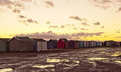 Beach Huts and Puddles