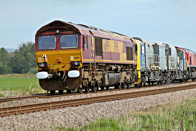 DB Cargo UK class 66 in EWS livery 66199 on rear of 3Z12 09.25 Knottingley T.M.D - Knottingley  T.M.D weedkiller train at Willerby Carr Crossing 3rd May 2020.