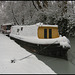 snow-wrapped houseboat