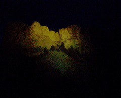 Mount Rushmore at night.