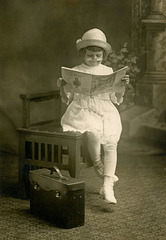 Girl Reading the North American Newspaper