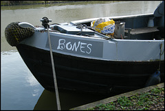 boring grey narrowboat sign