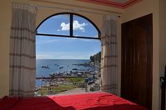 Bolivia, Copacabana, View of Lake Titicaca through the Window of the Hotel Mirador