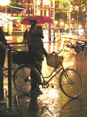Bike and umbrella by the rainy evening