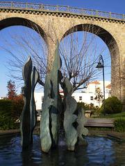 Fountain and pedestrians bridge.