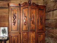 Closet in walnut tree wood.