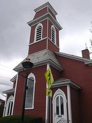 Religious pedestrian yellow sign