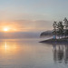 Sunrise on a foggy lake