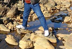 one foot in Portugal one foot in Spain.