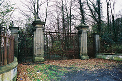 Entrance gates to Nettleham Hall, Lincolnshire (burnt 1937 and now an ivy covered ruin)