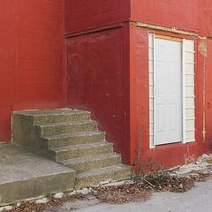 Walking upstairs and through a doorway.