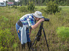 Jackie Tate photographing Platanthera conspicua (Southern White Fringed orchid)