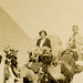 Tourists on Camels Near the Sphinx and Great Pyramid, Giza Necropolis, Cairo, Egypt (Cropped)