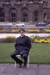 Man Sitting With Flowers, 1970