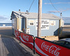 Triple Coca-cola fence by the beach