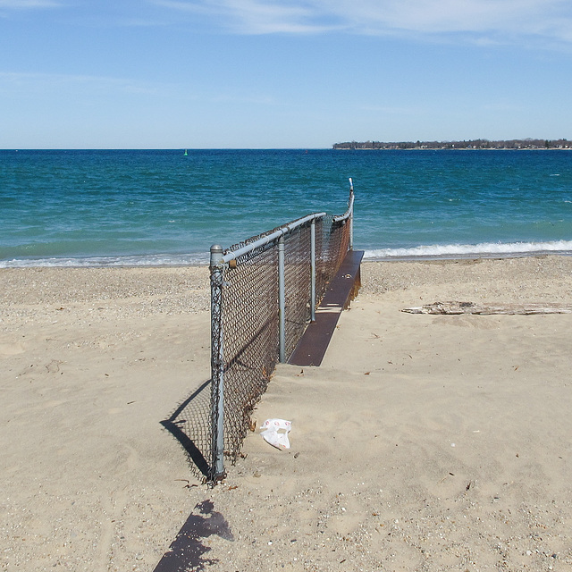 An installation of rusty chainlink at the spot where Lake Huron (left) pours into the St. Clair River (right).
