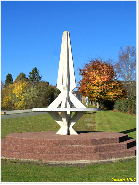 Monumental sundial at the village entry
