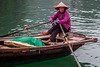 Fisher woman rows out selling souvenirs