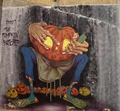 Halloween street art - the pumpkin butcher.