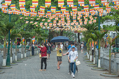 Local visitors walk to Tran Quoc Pagoda