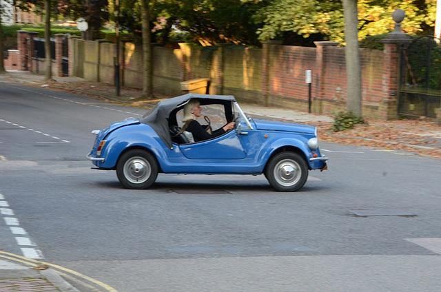 Blonde in a blue car