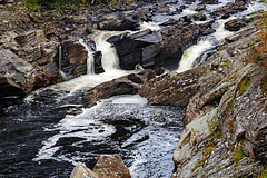 Stones Under Rushing Water