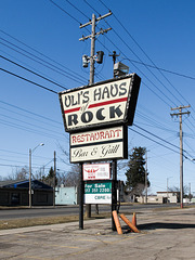 "Welcome to the typefaces and trapezoid of the rock restaurant ""Uli's."""