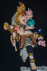 An Ogoh-Ogoh statue holds the globe