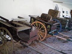 Horse-drawn trap and load wagons.