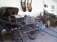 Horse-drawn landau and load wagon.