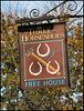 Three Horseshoes pub sign