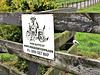 Sign on Farm Fence
