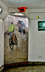 Cyclists reflected in the subway mirror