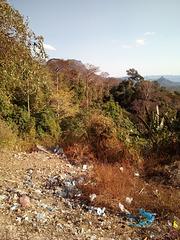 Hidden sceneries of horror hidden on tourist pamphlets (Laos)