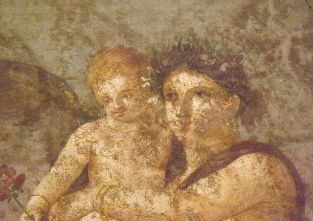 Detail of the Maenad and Cupid Wall Painting from the House of Caecilius Iucundus in Pompeii in the Naples Archaeological Museum, July 2012